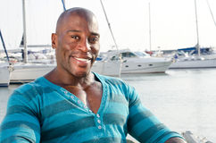 Summer marine scene with a handsome black man. Stock Photo