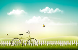 Summer meadow landscape with a bicycle. Royalty Free Stock Photo