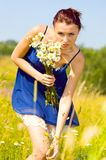 Summer meadow. woman with chamomile Royalty Free Stock Images