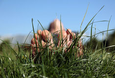 Summer meadow with woman feet Stock Images