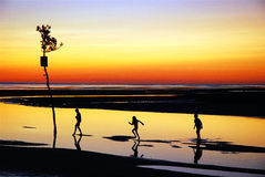Summer Memories, Cape Cod. Three children enjoy the fading summer sun in Cape Cod Royalty Free Stock Images