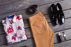 Summer men's clothing. Summer men's clothing on a dark wooden background Royalty Free Stock Images