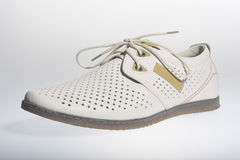 Summer men's shoes. Cream on a white background Royalty Free Stock Photography