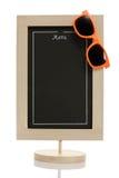 Summer menu chalkboard. Empty restaurant menu chalkboard with orange sunglasses isolated on white. Conceptual image - summer menu, beach menu Stock Photo