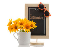 Summer menu chalkboard. Restaurant menu chalkboard with Summer word on it, orange sunglasses and yellow flowers in the cup isolated on white. Conceptual image Royalty Free Stock Images