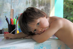 Summer midday boredom. The little girl in a weariness and boredom pose Royalty Free Stock Photos
