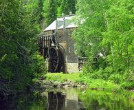 Summer Mill. A photo of a water powered saw mill taking at King's Landing, New Brunswick Stock Image
