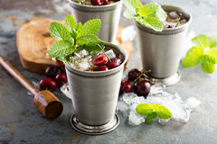 Summer mint julep cocktail. With sweet cherry Stock Photos