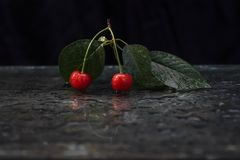 Summer, mirror, ripe cherry royalty free stock photography