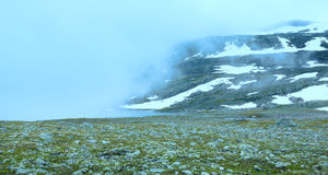 Summer misty mountain with lake and snow (Norway) Royalty Free Stock Photography
