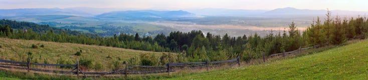 Summer misty mountain village Royalty Free Stock Photography
