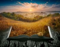 Summer misty valley on the pages of an open book Royalty Free Stock Photo