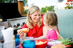 Summer: Mom Gets Hot Dog for Girl Royalty Free Stock Photo