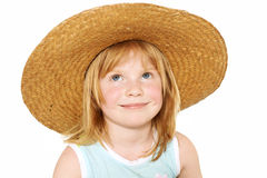 Summer mood. Cute redhead girl 4 years old covered with big broad-brim straw hat, isolated on white, clipping path Stock Photo