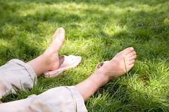 Summer mood. Sitting on the grass in a park Stock Images