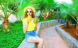 Summer mood! Fashion woman drinks a fruit orange juice Royalty Free Stock Photography