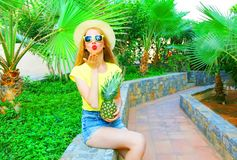 Summer mood! Fashion woman sends an air kiss Stock Image