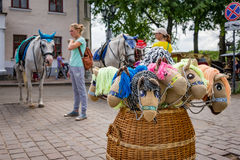 Summer mood: on the square of the ancient city of different types of horses. Royalty Free Stock Images