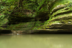 Summer morning in Illinois Canyon. Summer morning in Illinois Canyon as water flows lightly to the canyon floor.  Starved Rock State Park, Illinois Royalty Free Stock Photos