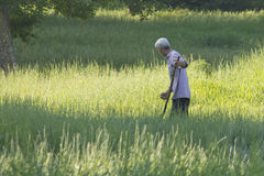 On a summer morning meadow. Mowing the grass on the summer meadow in the morning in a green area on the outskirts of Kharkov June 14, 2015 royalty free stock photos