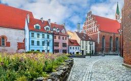 Summer morning on narrow street of old Riga, Latvia royalty free stock photos