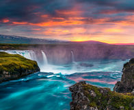 Summer morning scene on the Godafoss Waterfall. Colorful sunset on the on Skjalfandafljot river, Iceland, Europe. Artistic style post processed photo Stock Photo