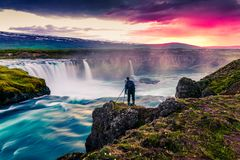 Summer morning scene on the Godafoss Waterfall with photographer. Colorful sunrise on the on Skjalfandafljot river, Iceland, Europ. E. Artistic style post royalty free stock images