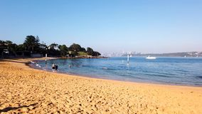 Camp Cove Beach, Sydney Harbour, Australia. Summer morning swimming at Camp Cove yellow sand beach, Sydney Harbour, NSW, Australia stock video footage