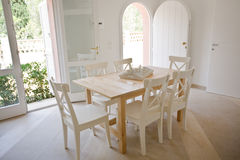 Summer morning. Wood table and chairs in a modern kitchen Stock Photos