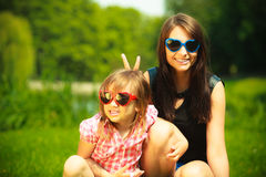 Summer. Mother and girl kid in sunglasses having fun Stock Photos