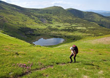 Summer mountain lake Nesamovyte and tourist Stock Images