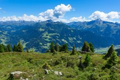 Summer mountain landscape with blue cloudy sky and hang glider. Austria, Tyrol, Zillertal Valley stock image