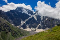 Summer mountain landscape of the North Caucasus. Snow-capped pea Royalty Free Stock Photos