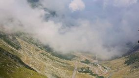 Summer Mountain Landscape (Romania). Summer mountainside landscape with winding mountain road and clouds. View from Transfagarasan road (Romania stock video