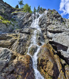 Summer mountain landscape of Shirlak waterfall in rocks of Altai Stock Photo