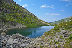 Summer Mountain Landscape: Stones Around Deep Cold Tarn Stock Image