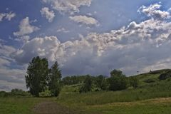Summer mountain landscape. Summer landscape on the mountain against the sky and clouds Royalty Free Stock Image