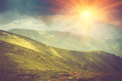 Summer mountain landscape at sunshine. Hiking trail in the hills. Royalty Free Stock Photo