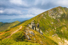 Summer mountain landscape at sunshine. Hiking trail in the hills. Royalty Free Stock Photography