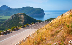 Summer mountain road with blue sky and sea Stock Photography