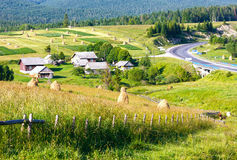 Summer mountain rural view with haystacks (Carpathian, Ukraine) Royalty Free Stock Image