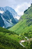 Summer Mountain View. Summer view of Caucasus mountains Dombain. Dombai, Russia royalty free stock image