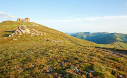 Summer mountain view with observatory ruins on top Royalty Free Stock Photo