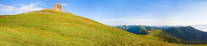 Summer mountain view with observatory ruins on top Royalty Free Stock Image