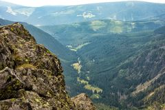 Summer in the mountains. Beautiful panorama for a postcard or calendar. View of the verdant slopes and hills and valleys. Mountain stock image