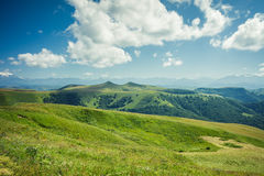 Summer mountains green grass and blue sky Stock Photo