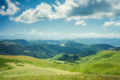 Summer mountains green grass and blue sky Royalty Free Stock Photo