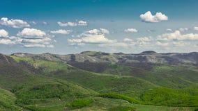 Summer mountains hills green grass and blue sky stock video