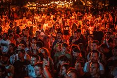 Summer music festival crowd partying outdoor. KIEV-11 JULY,2018: Group of happy young people listening to music on summer festival Bazar in night club.Concert stock photos