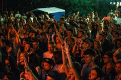 Summer music festival crowd partying outdoor. KIEV-11 JULY,2018: Group of young music fans listenign to the music on hip hop summer festival Bazar outdoor stock photo